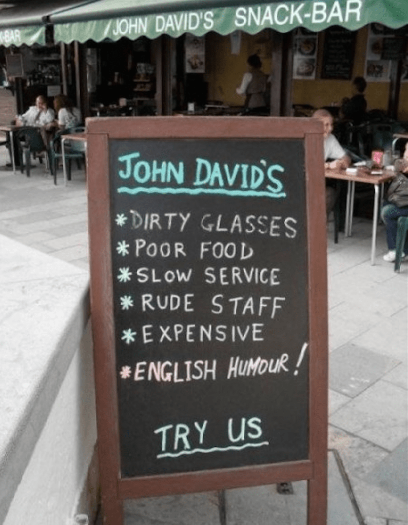 Get it? English humor on a sandwich board.